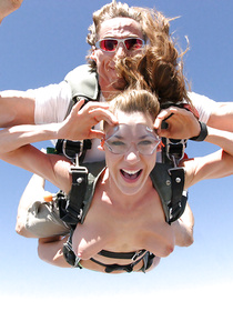 Sweet women are practicing parachute jumping and flashing their tits when flying in the air. They are also enjoying passionate group sex.