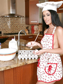 The slutty woman is cooking in the kitchen when her lover comes in. She starts playing with his cock and demonstrating her cowgirl skills.