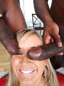 Wonderful woman is getting her pussy and anal penetrated with two chocolate cocks. She is also presenting these ebony guys with blowjob.