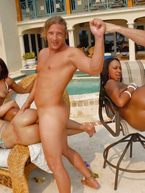 Big swimming pool is a cool place for fucking three chocolate ladies. They are getting their wet holes penetrated with white penis.