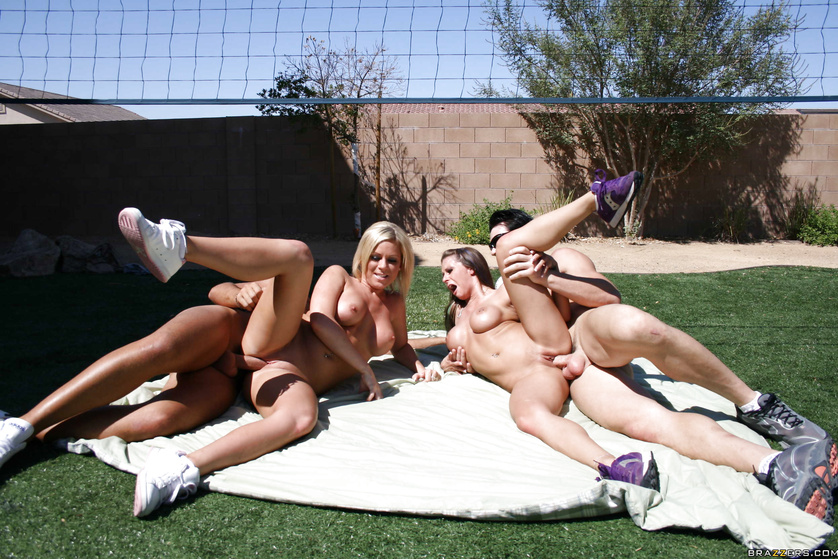 Nudist Girls And Guys Enjoy Playing A Beach Volleyball